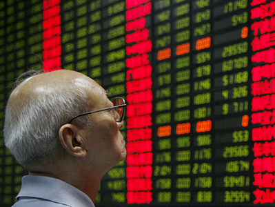 [An investor looks at the stock-price monitor at a private-security company in Shanghai Tuesday, as Chinese stocks plunged.]