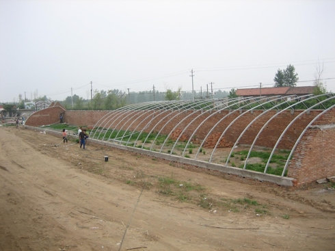 Picture #7: Uncompleted greenhouse.  Does this look like something that's going to $38 million investment to build?