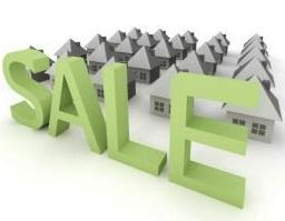 """Graphic of houses with large """"sale"""" sign"""
