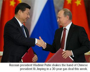 Vladimir Putin and Xi Jinping shake hands 30 year Gas Deal