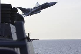 Russian flyby over US navy ship.