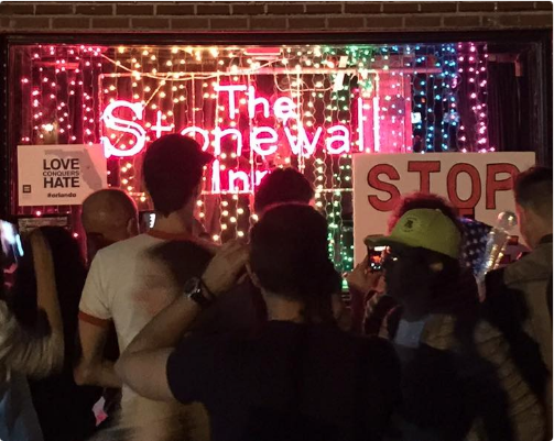 Photo of vigil at the Stonewall Inn vigil for Orlando victims, via Bill Easterly