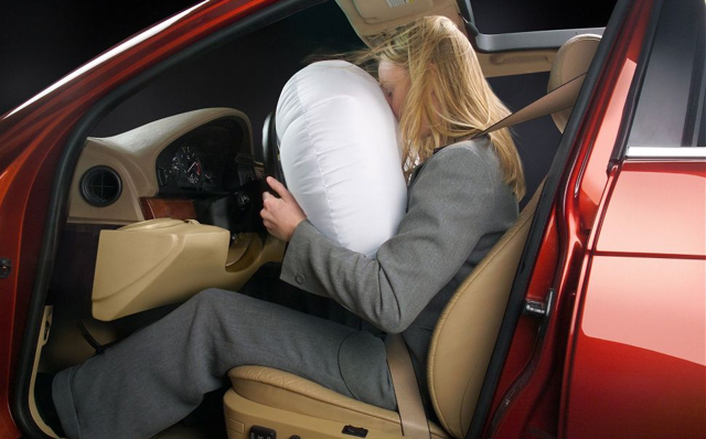 A model demonstrates an adaptive airbag. Via Automotive.com: http://www.automotive.com/news/trw-improves-safety-with-introduction-of-next-generation-adaptive-airbag-68461/