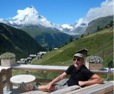 John on Deck Overlooking Alps